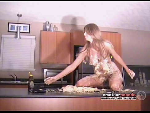 Naked woman covered by whipped cream